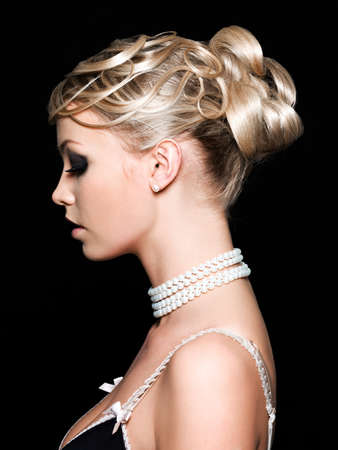 Profile of beautiful young woman with fashion hairstyle Stock Photo - 7058210