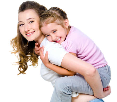 Young happy mother with little girl on her back - isolated on white photo