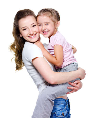 mother and daughter: Happy beautiful young mother holding her little cheerful daughter - isolated on white Stock Photo