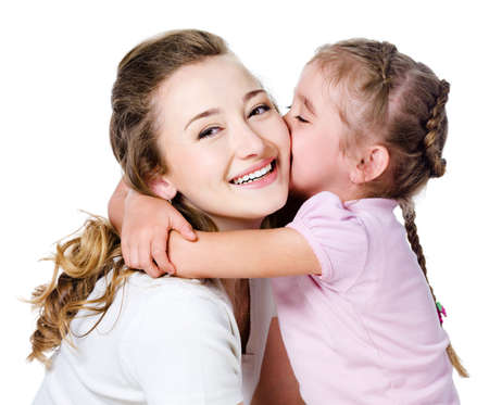 daughter mother: Little pretty daughter kissing and embracing her happy mother