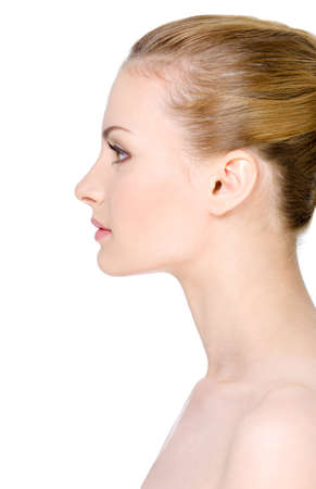 Beautiful clean young woman's face in profile - isolated on white Stock Photo - 7281581