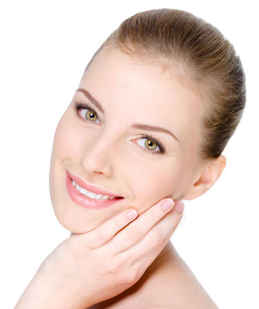 Close-up portrait of young beautiful woman's face with happy cheerful smile on it - white background Stock Photo - 7281562