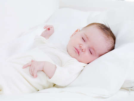 sweet dreams: Close-up portrait of innocence little newborn baby in sweet dreams - indoors