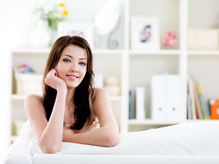 Portrait of young beautiful brunette woman with easy smile at home - indoors Stock Photo - 7299392