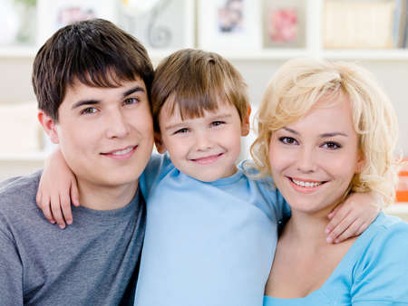 Close-up portrait of happy smiling family with little son - indoors Stock Photo - 7314989