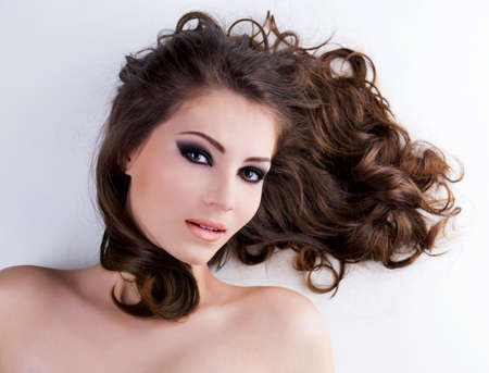 Portrait of a beautiful  woman with  long brown hairs Stock Photo - 7337524