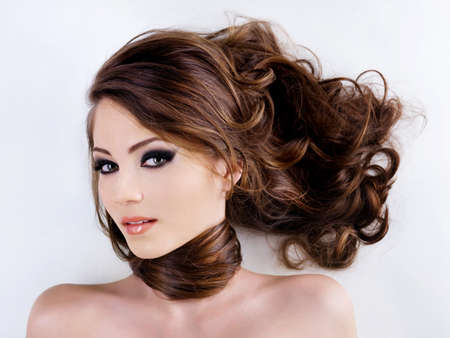 Sensuality and attractive young woman face with beauty hairs photo