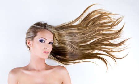 Beauty female face with long blond straight hair and bright blue make-up Stock Photo - 7337523