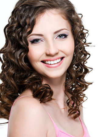 Close-up portrait of happy cheerful young beautiful woman with curly hair photo
