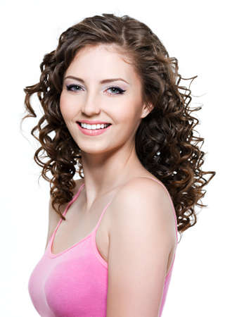 Beautiful happy cheerful young woman with brown curly hair