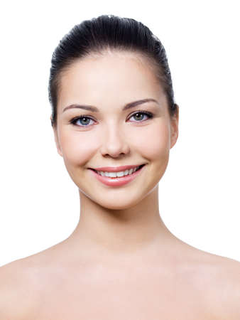 bared teeth: Beautiful smiling face of young woman with healthy clean skin - isolated Stock Photo