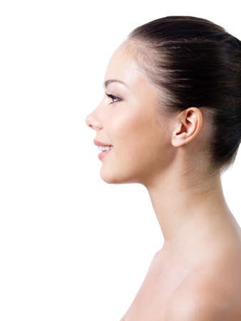 Beautiful young woman's face with healthy clean fresh skin in profile - isolated Stock Photo - 7337579