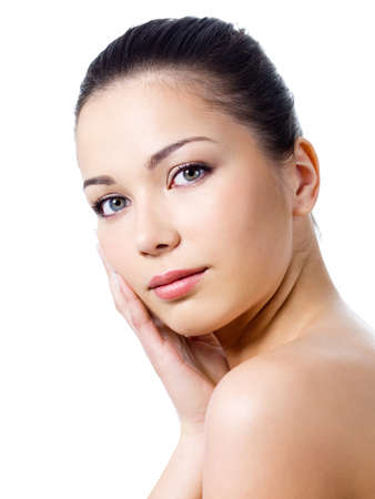 Close-up portrait of young beautiful woman with healthy skin touching her face - isolated Stock Photo - 7337590
