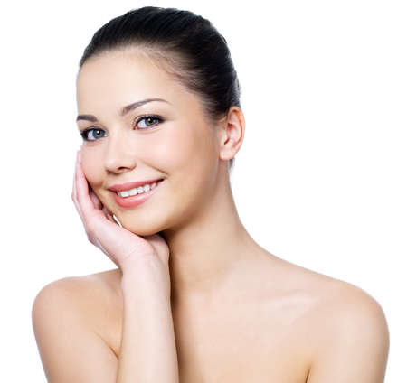 Happy beautiful woman's face with fresh clean skin - isolated on white background Stock Photo - 7337559