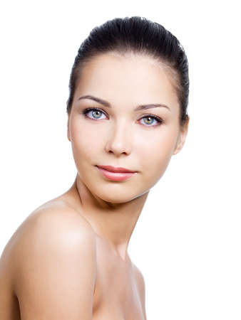Portrait of beautiful woman with pretty face with clean skin on it - white background Stock Photo - 7337580