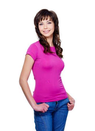 分離 - 魅力的なの明るい笑顔で立っているカジュアルで美しいブルネットの若い女性 写真素材