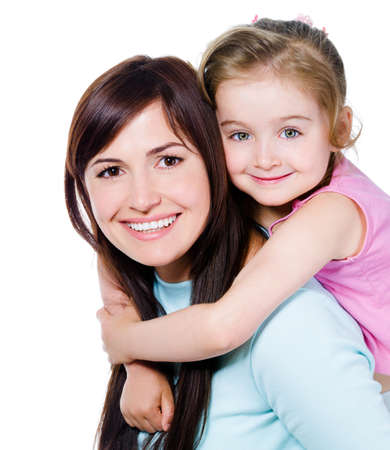 mother child: Happy portrait of beautiful young mother with little pretty daughter - isolated on white
