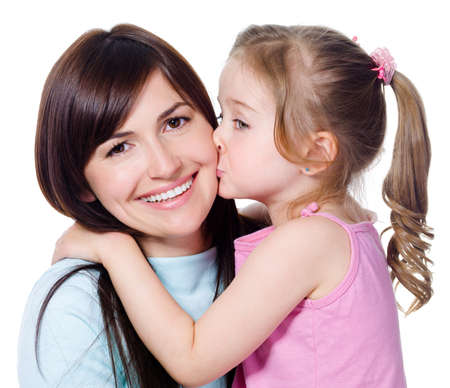 mom daughter: Portrait of little daughter kissing her beautiful happy mother - isolated on white