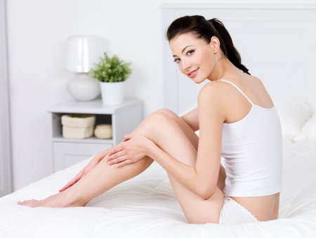 Beauty of young pretty woman with perfect shape and clean fresh beatiful legs - indoors photo