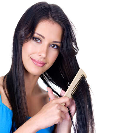 Close-up portrait of beautiful pretty woman with comb caring about her long hair - isolated Stock Photo - 7337596