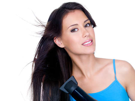 Close-up portrait of sensuality beautiful woman drying her long hair with hairdryer photo