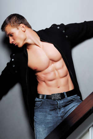 macho: Sexy  bodybuilder posing in studio. Big muscles.
