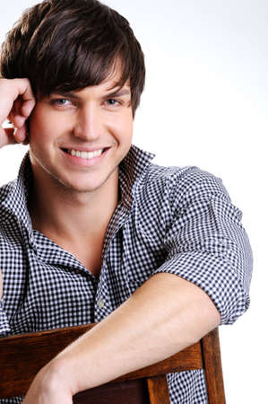 toothy: Portrait of an attractive guy with toothy smily posing at studio