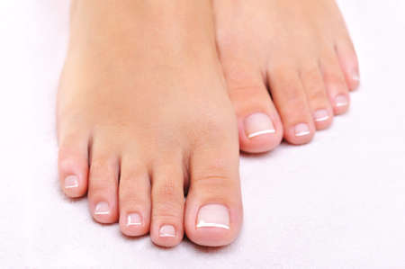 human toe: beauty pure female feet with french pedicure