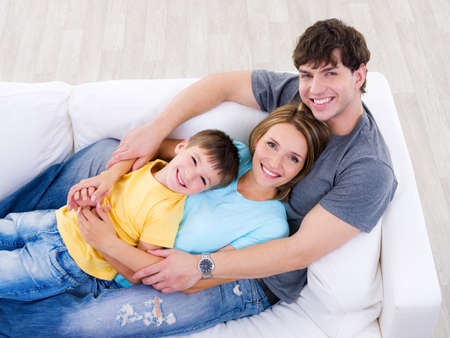 family on couch: Friendly happy laughing family on the sofa - high angle Stock Photo