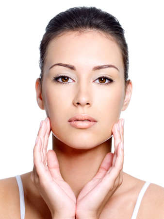 Front view of young beautiful woman's face with healthy fresh clean skin - close-up Stock Photo - 7416232