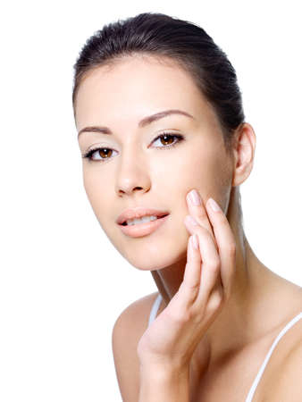 Sensual young beautiful woman stroking her healthy clean skin on face - isolated Stock Photo - 7416227