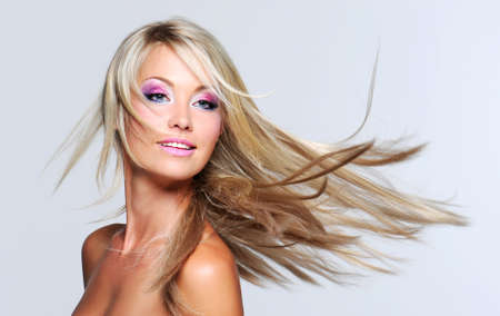 Beautiful woman with long straight hair and multi colored makeup Stock Photo - 7424736