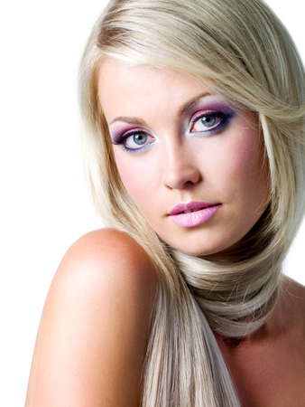 Beautiful face with satured colors of make-up and straight long hair photo