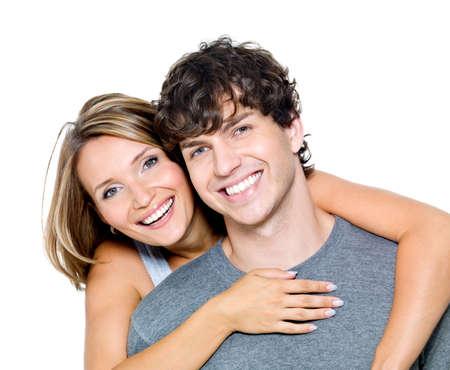 pareja saludable: Retrato de una hermosa joven feliz sonriente pareja - aislada  Foto de archivo
