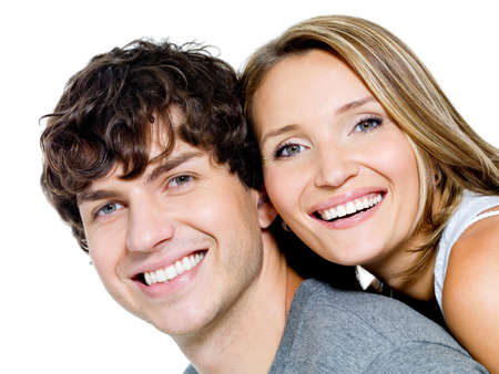 teeth white: Portrait of a beautiful young happy smiling couple - isolated