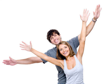 hands lifted: Two young happy person with the hands lifted upwards