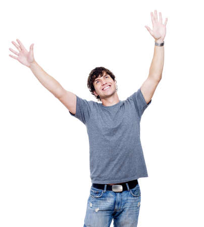 hands lifted: Portrait of young happy man with hands lifted upwards