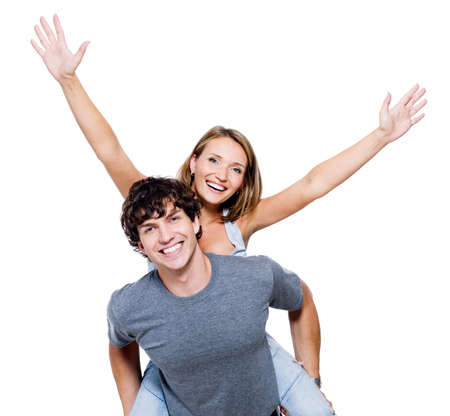 Two young happy person with the hands lifted upwards photo