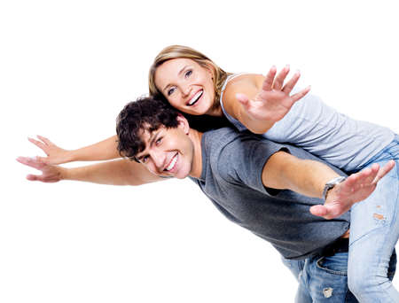 lady fly: Two young happy person with the hands lifted upwards
