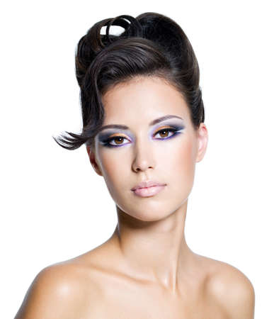 modern girls: Beautiful face of a glamour woman with modern curly hairstyle and brightly makeup Stock Photo