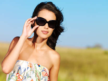 beautiful sexy woman on the nature in black sunglasses photo