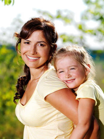 Happy portrait of the mother and little daughter outdoors Stock Photo