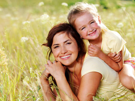 Smiling mother and little daughter on nature. Happy people outdoors Stock Photo - 7506829