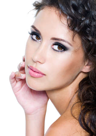 Beautiful face of young woman with clean skin. Girl with long curly hairs. Bright eye make-up Stock Photo - 7506917