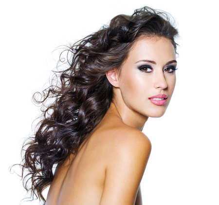 nude black women: Beautiful face of young woman with clean skin. Girl with long curly hairs. Bright eye make-up