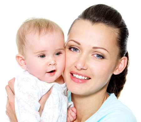 Portrait of a beautiful young mother with sweet newborn child Stock Photo - 7525009