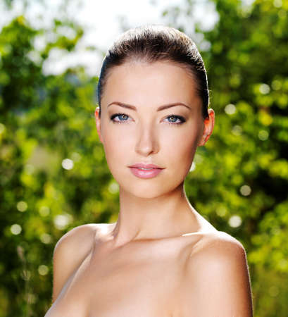 Face of a sexy beautiful young woman with clean skin - outdoors Stock Photo - 7525046