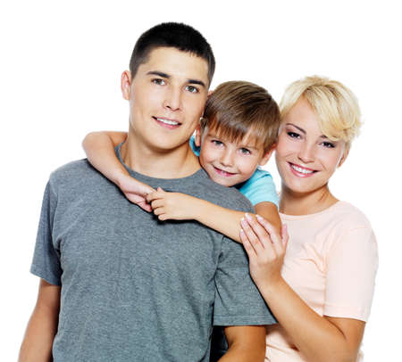 Happy young family with son of 6 years posing over white background Stock Photo - 7561169