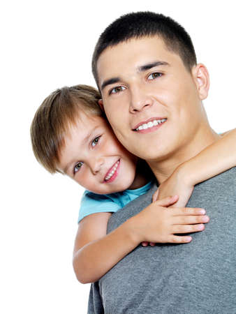 Happy portrait of the father and son of six years. Isolated on white Stock Photo - 7608211