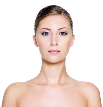 Portrait of a young pretty woman with clean skin on a white background Stock Photo - 7817272
